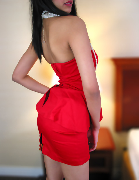 East Indian girl working as escort in toronto. she is wearing a red dress
