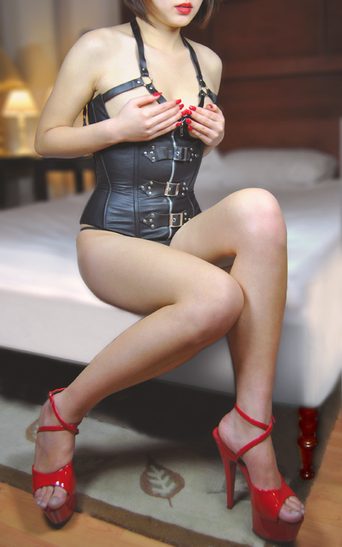 Asian escort in leather in toronto hotel